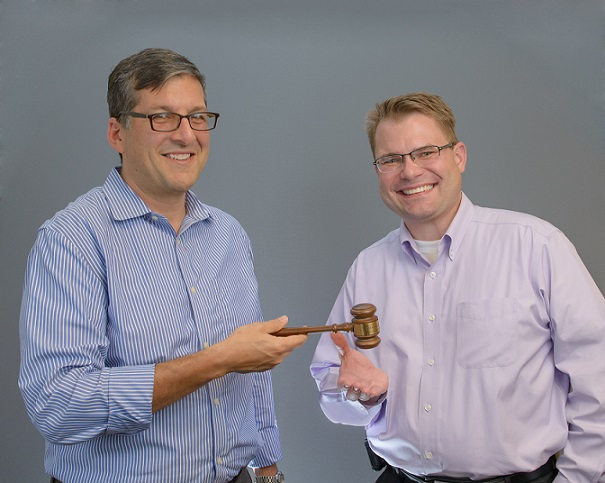 Outgoing board president Mauro Hernandez (lt) passes the gavel to current board president, Darrin Buckner.